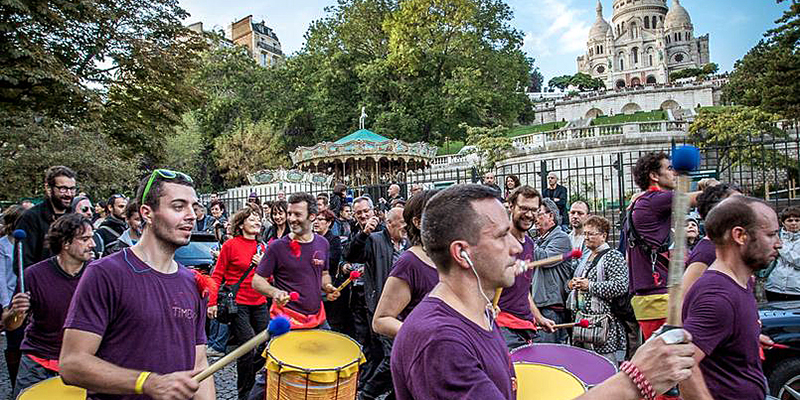 Parisians celebrate the tradition of wine making at the Fete de Vendanges in the Montmartre